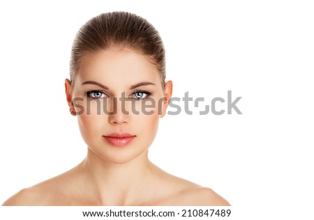 Natural beauty of lovely woman with perfect healthy skin and naked shoulders. Portrait of young pretty female posing in studio.    - stock photo