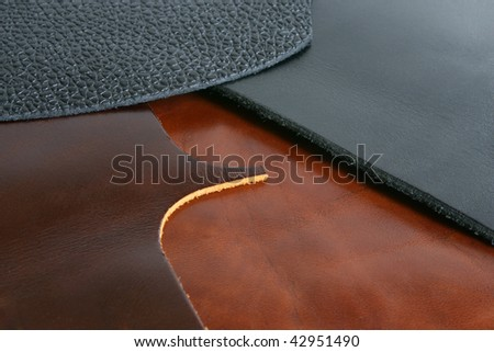 Natural black and brown leathers background closeup - stock photo