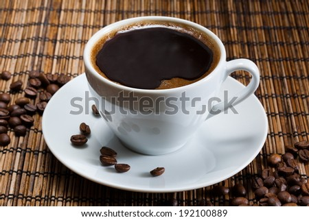 natural black coffee in a white cup - stock photo