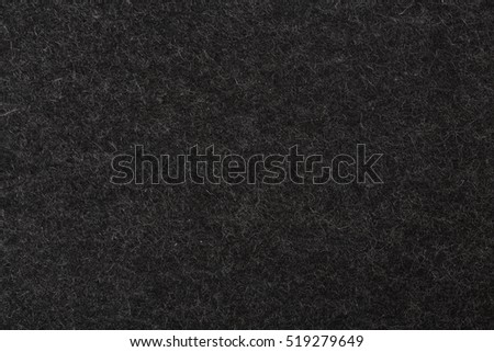 Natural black felt abstract background. High resolution photo.