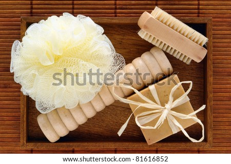 Natural body care accessories gift kit with block style bar aromatherapy soap and loofah scrub sponge with foot massager and soft brush for a pampering hygiene bath treatment in a naturalist spa - stock photo