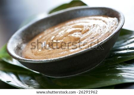 Natural body care green tea scrub closeup - stock photo