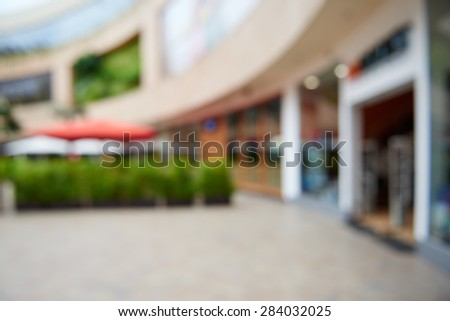 Natural bokeh out of focus shopping mall - stock photo
