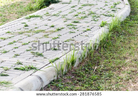 Natural brick path along the urban park. - stock photo