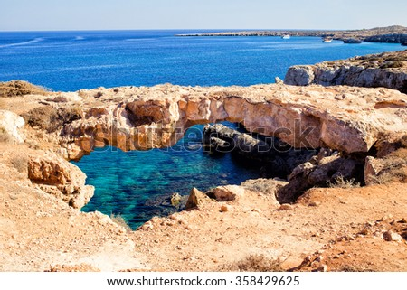 Natural bridge in Cavo Cape Greco, at National Forest Park, Ayia Napa. Turquoise water in the Mediterranean Sea