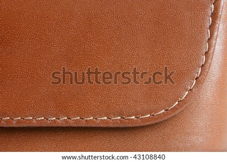 Natural brown leather background closeup - stock photo