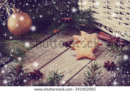 Natural christmas decor with ginger cookies, anis and fir tree on wooden background - stock photo