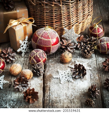Natural Christmas Gifts in Country style with Basket Red, Balls, Pine cones, Pine cones, Boxes, Walnuts Snowflakes - stock photo