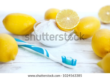 Natural cleaners baking soda, lemon and tooth brush
