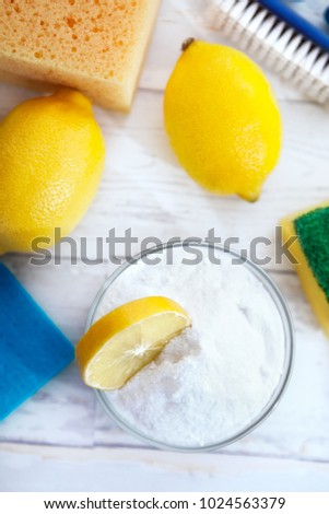 Natural cleaners, lemon and baking soda with sponges and cleaning brush