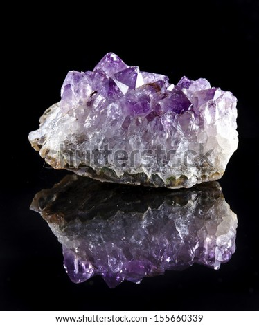 Natural cluster of Amethyst, violet variety of quartz close up macro with reflection on black surface background  - stock photo