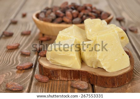 Natural cocoa butter on a brown background - stock photo