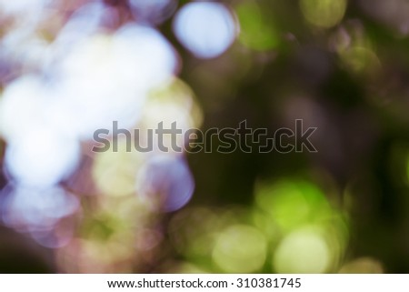 Natural colored blurred background with natural bokeh - stock photo