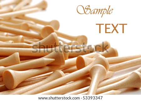 Natural colored wooden golf tees on white background with copy space.  Macro with shallow dof. - stock photo