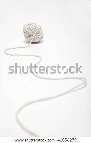 natural colored wool ball on white background - stock photo