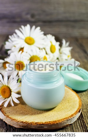 Natural cosmetics concept. Jar with cosmetic cream on a wooden surface.