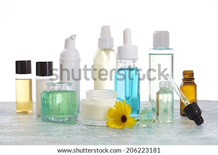 Natural cosmetics - Essence  and cream with fresh calendula - stock photo