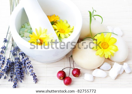 Natural cosmetics (lavender, rosemary and marigolds), still life background. - stock photo