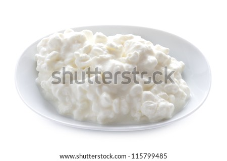 natural cottage cheese in a dish isolated on a white background - stock photo