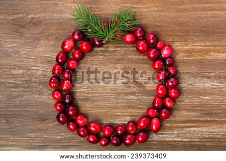 Natural Cranberries Wreath on Wooden Background - stock photo