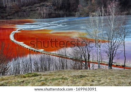 Natural disaster. Pollution of a lake with contaminated water from a gold mine  - stock photo
