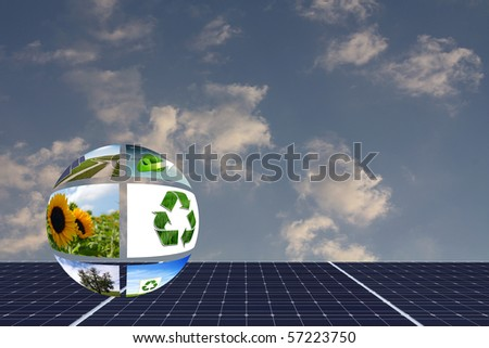 natural energies concept with solar panels and a eco ball against sky - stock photo