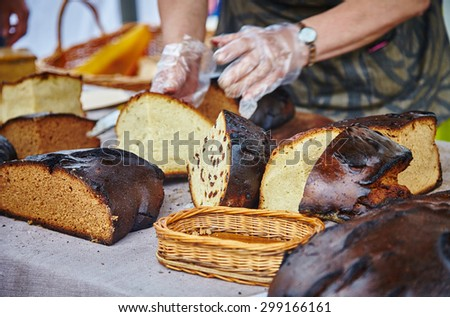 Natural european hand made bread. Black bread. Baked bread servings on wooden board made using ancient bakery methods - stock photo