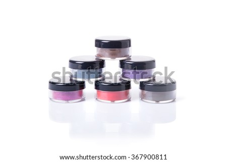 Natural eye shadows in transparent jars, isolated on white background  - stock photo