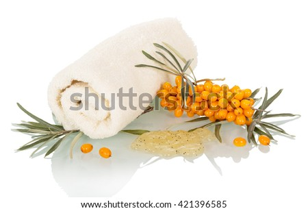 Natural facial scrub of sea buckthorn berries and towel isolated on white background. - stock photo