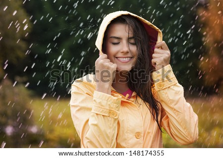 Natural female beauty in autumn rain - stock photo