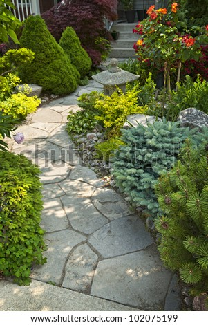 Natural flagstone path landscaping in home garden - stock photo