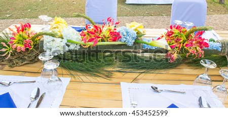 Natural flower design on meal table, forest style of floral arrangement.