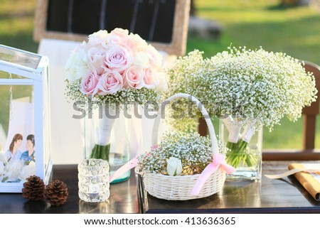 Natural flowers bouquet and decoration objects of wedding on the beach - stock photo