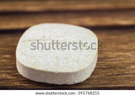 Natural food supplement pills multivitamin, vitamin c, macro image, selective focus - stock photo