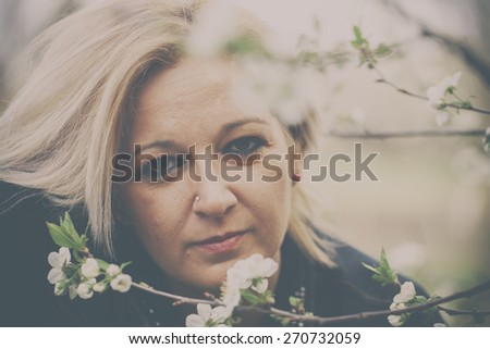 Natural forty years old blonde woman. Analog effected photo