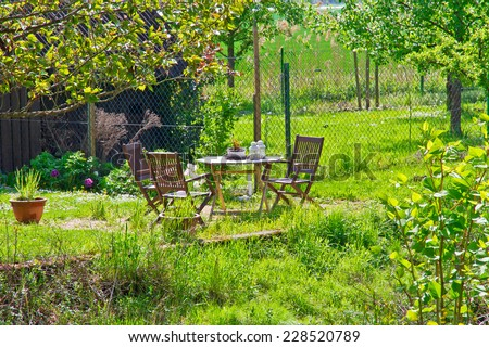 Natural garden with furniture - stock photo