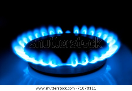 Natural gas in the home, a blue flame. - stock photo