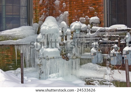 Natural Gas Meters covered in ice - stock photo