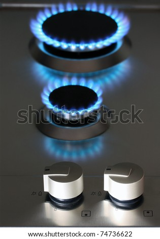 natural gas power supply, focus on control knob - stock photo