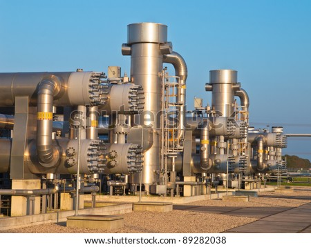 Natural gas processing site during sunset. Modern equipment is used to mine the last remainder from the field. - stock photo
