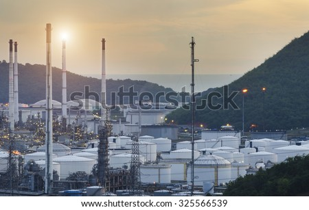Natural Gas storage tanks and oil tank in industrial plant at sunset , Oil Refinery factory , petrochemical plant , Petroleum ,  - stock photo