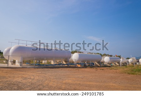 Natural Gas storage tanks in industrial plant. - stock photo