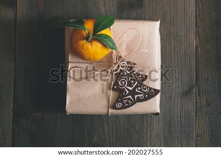 natural gift wrap for the holdays with clementine - stock photo