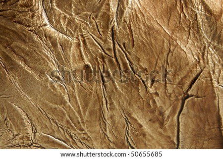 Natural golden leather background closeup - stock photo