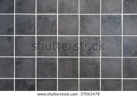 natural gray stone square tiles with white filling - stock photo