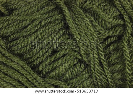 Natural green fine wool threads texture, horizontal textured clew macro closeup background pattern