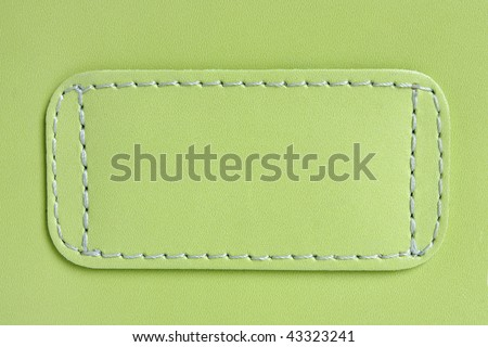 Natural green leather background closeup - stock photo