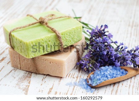 Natural handmade Herbal Soap with leaves and sea salt - stock photo