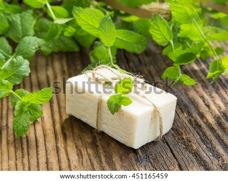 Natural handmade soap with mint leaves plant