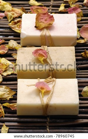 natural handmade soap with rose petals on mat - stock photo